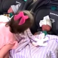 Watch this tot welcome her baby twin siblings home from the hospital