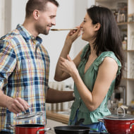 Couple cooking dinner, tasting