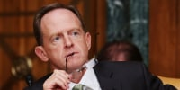 Image: Republican Sen. Pat Toomey of Pennsylvania listens to testimony
