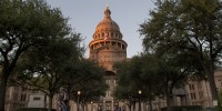 Image: A cyclist passes in front of the Texas State Capitol building in Austin, Texas