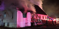 Firefighters work to put out a fire at Martin Luther King Jr. Community Presbyterian Church in Springfield, Mass., on Dec. 28, 2020.