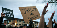 Image: Protesters gather outside the Brooklyn Center Police Department calling for justice for Daunte Wright