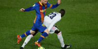 Image: Barcelona's Lionel Messi, left, vies for the ball with Real Madrid's Ferland Mendy during the Spanish La Liga soccer match between Real Madrid and FC Barcelona at the Alfredo di Stefano stadium in Madrid, Spain