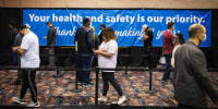 Vaccine-Givers Race Time at an Atlantic City Convention Hall