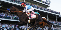 Medina Spirit #8, ridden by jockey John Velazquez, crosses the finish line to win the 147th running of the Kentucky Derby in Louisville, Ky., on May 1, 2021.