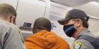 Image: Delta flight diverted after man tries to open door.