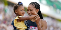 Allyson Felix celebrates after her second place finish in the women's 400-meter run with her daughter Camryn at the U.S. Olympic Track and Field Trials on June 20, 2021, in Eugene, Ore.