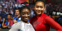 Gold medal winner Simone Biles of the U.S., left, and her team mate Sunisa Lee pose after the women's all-around final at the Gymnastics World Championships in Stuttgart, Germany, Thursday, Oct. 10, 2019. (AP Photo/Matthias Schrader)