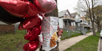 A memorial to five people who were shot to death adorns a tree in Milwaukee on April 28, 2020.