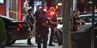 Police respond to the scene of a shooting in Queens, N.Y., on July 31, 2021.