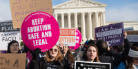 Abortion rights activists hold signs alongside anti-abortion activists outside the Supreme Court in 2019.