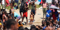 Haitian migrants gather on the banks of the Rio Grande after they crossed into the United States from Mexico on Sept. 18, 2021, in Del Rio, Texas.