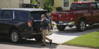 An FBI agent leaves the Florida home of Brian Laundrie on Sept. 26, 2021.