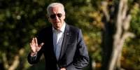 Image: U.S. President Joe Biden walks from Marine One as he returns to the White House in Washington