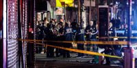 New York City police officers gather near the site of shooting in the Brooklyn borough of New York on June 4, 2020.