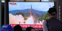People in Seoul, South Korea, watching a TV showing a file image of North Korea's missile launch on Tuesday, Sept. 28, 2021.