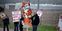Image: First shift worker Travis Huffman joins other BCTGM Local 3G union members in a strike