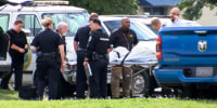 Emergency personnel remove the body of Christina Nance from a police van in Huntsville, Ala.