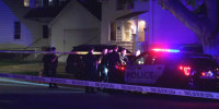 Police respond to the scene of a shooting in Kenosha, Wis., on Oct. 19, 2021.