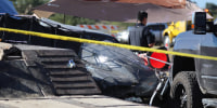 The scene of a crash in Texas, where two children were killed and eight people were injured when a drag racer veered off track Saturday.