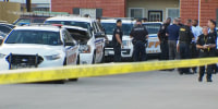 Police outside an apartment in Houston where the remains of an 8-year-old child were found.