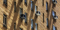 Air conditioners adorn a building in New York.