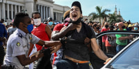 Image: A man is arrested during a demonstration against the government of Cuban President Miguel Diaz-Canel in Havana, on July 11, 2021.