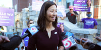 Boston mayoral candidate Michelle Wu speaks with the media after casting her ballot on Election Day in Boston on Sept. 14, 2021.