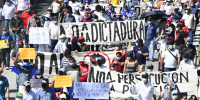 People protest against in San Salvador, El Salvador, on Oct. 17, 2021.
