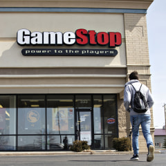 Illustration of a man playing a video game with a gaming console and a Man walking into a Game Stop store