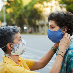 A caring mother is adjusting her teenager son's COVID mask, Shop the best masks to wear for comfort and breathability, according to doctors. Healthcare professionals share their favorite face masks to wear while off-duty.
