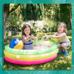 Two children having fun in inflatable swimming pool and Portrait of two happy girls in an inflatable swimming pool with parents