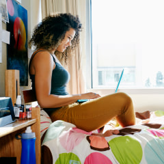 Image: College student using laptop in dorm