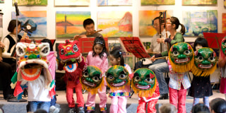 essay celebrating chinese new year far from home and family chinese lunar new year presentation and lion dance performance w ann arbor chinese center of michigan lion dance team at the ann arbor district library