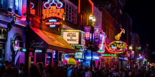 Image::Image: Neon signs on Lower Broadway (Nashville) at Night|Getty Images stock