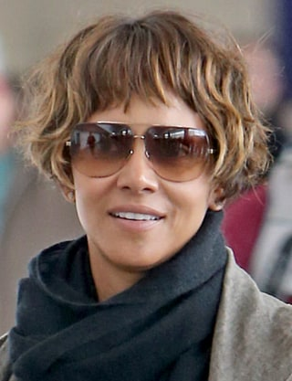 Halle berrys new short hairstyle is a bowl cut halle berry smiles upon arrival to jfk airport in new york ryan turgeon splash news urmus Image collections