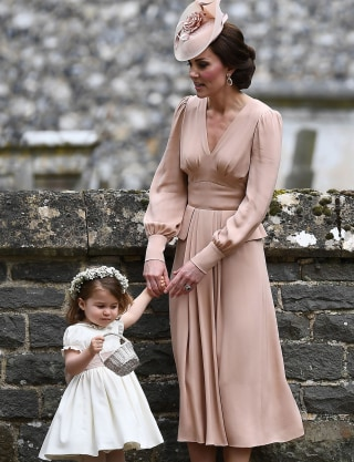 Pippa middleton wedding see what bride and sister kate middleton wore duchess kate stands with her daughter princess charlotte following the wedding of her sister pippa middleton to james matthews afpgetty images junglespirit Images