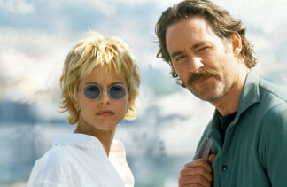 Meg ryan shares the hot story behind her famous haircut meg ryan and kevin kline in french kiss alamy stock urmus Choice Image