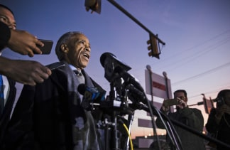 The Rev. Al Sharpton speaks with members of the media after visiting rapper Meek Mill. Matt Rourke / AP
