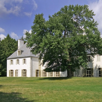 Absolute privacy of Le Beau Château, the Clark estate in New Canaan, Conn. The house at 104 Dan's Highway cannot be seen from the road. Nearby residents of New Canaan include singer-songwriter Paul Simon and pianist-actor Harry Connick, Jr. It's an hour's drive to Manhattan.