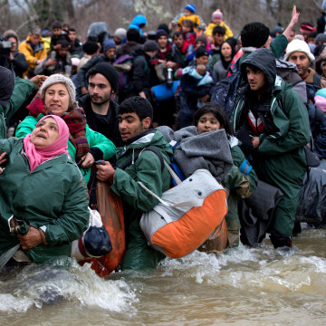 Image: Frustrated Migrants Stranded On The Border Attempt To Walk In To Macedonia