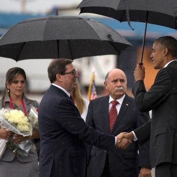 Image: President Barack Obama, right, shakes hands with Cuba's Foreign Minister Bruno Rodriguez as first lady Michelle Obama stands behind