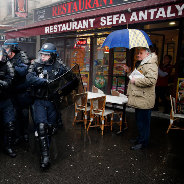 Image: French police clash with demonstrators during a protest against the labor law reform bill in Paris