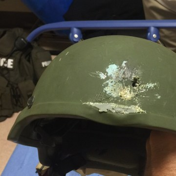 An Orlando police officer was hit in the hail of gunfire as a SWAT team entered the club and killed the assailant. According to Orlando Police, this Kevlar helmet saved the officer's life.