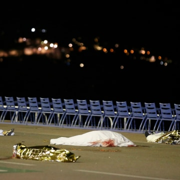 Image: Bodies are seen on the ground after a heavy truck ran into a crowd at high speed killing scores celebrating the Bastille Day July 14 national holiday on the Promenade des Anglais in Nice
