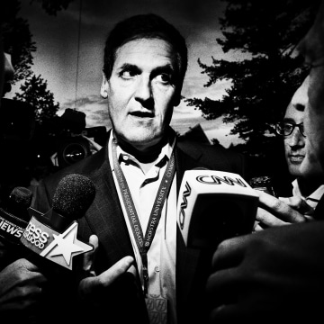 Mark Cuban talks to a crowd of reporters.