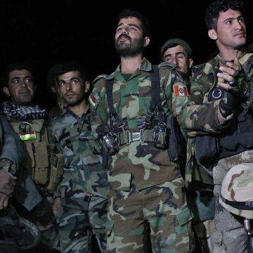 A soldier named Awara sings with fellow fighters with the Kurdistan Freedom Party (PAK), a Kurdish militant group affiliated with the Peshmerga, the night before the offensive. He was known as a fine singer by PAK members and often led the singing to boost morale.  Awara was killed the next day when his unit was attacked by ISIS.