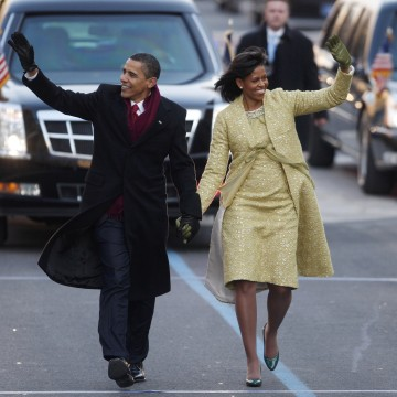 Image: Barack and Michelle Obama walk down Pennsylvania Avenue in Washington