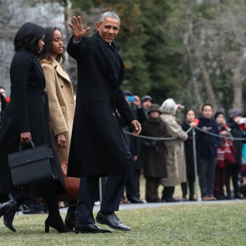 Image: President Obama waves as he walks with first lady Michelle Obama and daughter Malia toward Marine One while departing from the White House on Jan. 10.