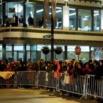 Image: People line a street while trying to catch a glimpse of President Obama, who was making a stop nearby on his way to deliver his farewell address in Chicago, Illinois on Jan. 10.